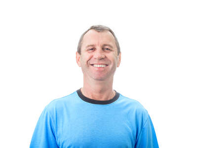 Happy middle age man smiling wearing casual t-shirt isolated over white background. Portrait of cheerful older man smiling isolated on white background. Middle age Positive emotions