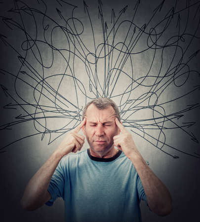 Middle aged man suffering headache and depression, keeps fingers to his temples, eyes closed. Fatigue senior male anxiety and migraine symptoms. Mess lines and curves sketch comes out of his head
