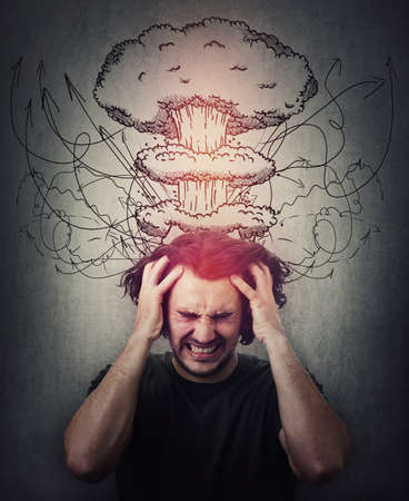 Head explosion metaphor. Bewildered man messing up and pulling his hair, eyes closed screaming and clenching teeth. Suffering headache, dementia disease. Mental health concept, migraine and anxiety