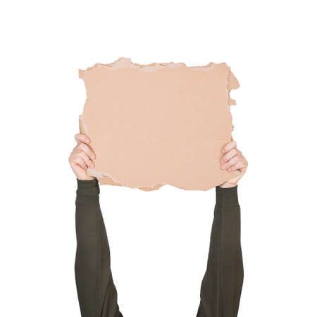 Activist hands holding up a blank cardboard sheet, engaged in a street demonstration or protest. Blank banner for advertising and messages isolated on white background. Announcement placard copy space