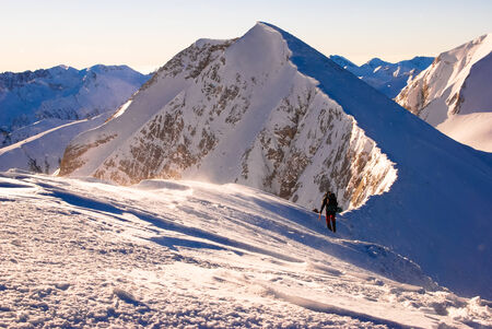 ridges: Hiking in the winter. Sharp ridges, steep slopes and avalanches, peak over the clouds. Pirin,Bulgaria.