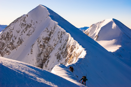 alpinism: Hiking in the winter. Sharp ridges, steep slopes and avalanches, peak over the clouds. Pirin,Bulgaria.