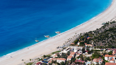 oludeniz: Aerial view of town and beach. Yachts are waiting tourist on the beach. Oludeniz, Fethiye, Turkey