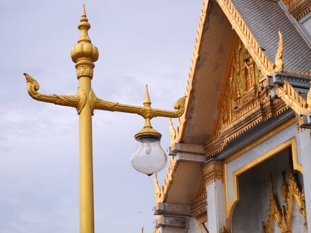 refinement: lamp post with golden temple background in Thailand. Stock Photo