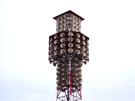 soundsystem: Loudspeaker or Megaphone broadcasting pillar outdoor on white sky