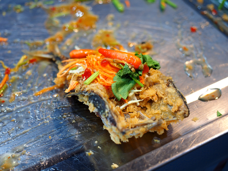 sweet and sour: Fried mackerel topped with sweet, sour and hot spicy sauce sale in market - close up food
