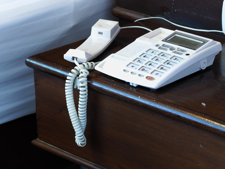 disregard: hang up white telephone on the wooden table