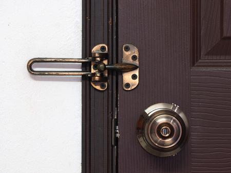 door bolt: doorknob and bolt or latch with wooden door - security