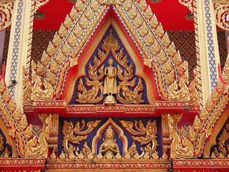 gable: Golden Buddha and angel on gable chapel