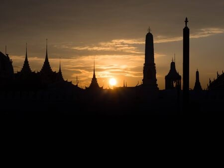 silhouete: Temple silhouete against the sky on a sunset, wat phra kaew, thailand