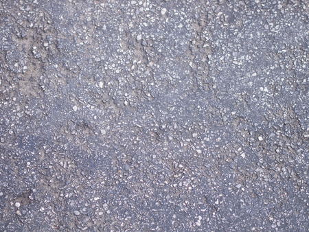 Texture of rough asphalt, Dark grey road with small rock and crack, Background
