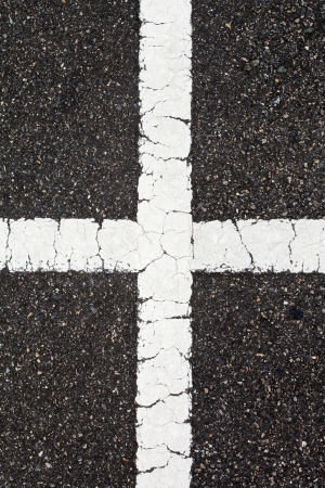 Asphalt with cross white line photo