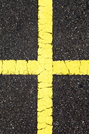 Asphalt with cross yellow line Stock Photo