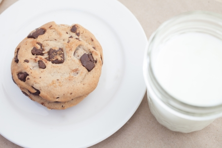 Cookie with Dark Chocolate and a Jar of Milk