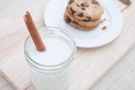 A Jar of Milk with Dark Chocolate Chip Cookies