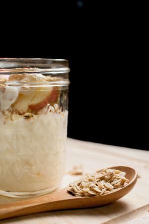 Glass of yogurt with muesli and fruit