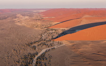 View from a Helicopter of the large red sand dunes in the Namib Naukluft Park, Sossusvlei, Namibia