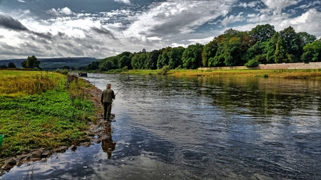 An angler on the river photo