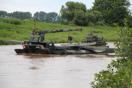 armed: The Armed Forces tank by the river