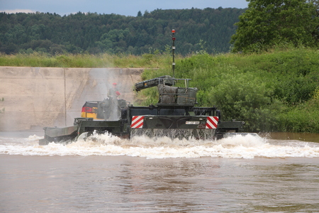 The Armed Forces tank by the river