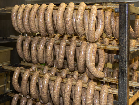A batch of bratwursts is waiting for their final destzination