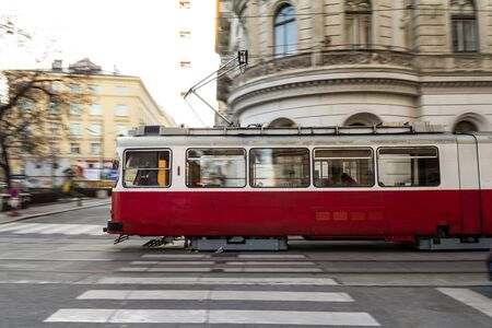 A red and white tramway on its fast way through vienna