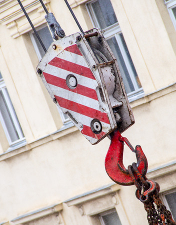 A huge hook used in craning for securing objects for transport.