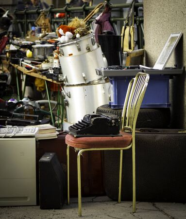 A variety of objects for sale at an outdoor flea market