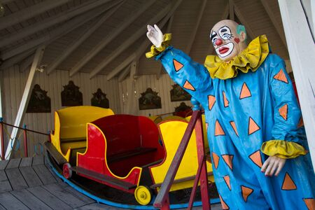 A spooky Clown trying to lure guests to the Merry-Go-Round