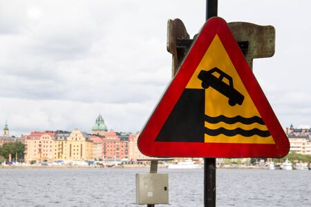 A street sign warning for the roads end