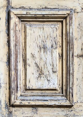 An old woooden frame with peeling paint