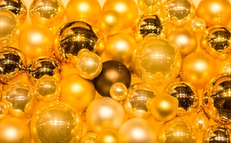 A multitude of golden and yellow christmas balls