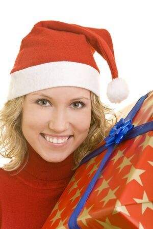 Young woman with red hat and a christmas present photo