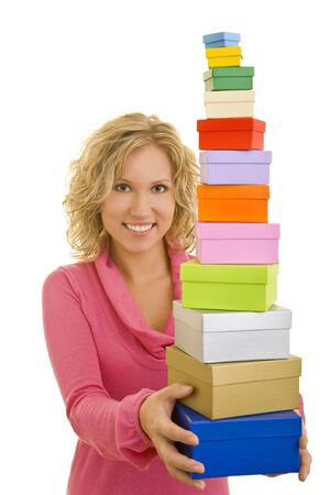 Young woman holding a stack of gift boxes photo