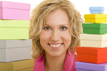 Young woman holding two stacks of gift boxes photo