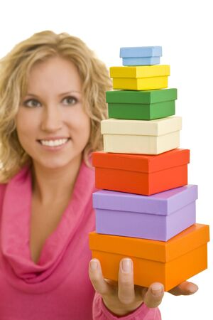 Young woman holding a stack of seven gift boxes Stock Photo - 3789409