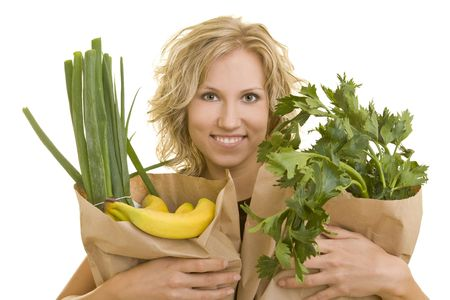Smiling woman carries fruits and vegetables in brown paper bags Stock Photo - 3915308