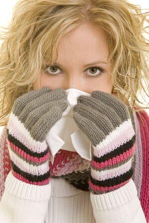 Blond woman using a tissue handkerchief photo