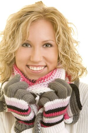 shivering: Smiling blond woman with a scarf and gloves Stock Photo