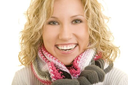 Smiling blond woman with scarf and gloves photo