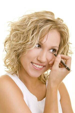 20 25: Blonde woman using eyeliner on her eyes