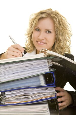 Blonde business woman working on a stack of folders photo
