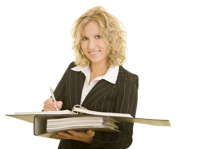 making notes: Young blonde woman making notes Stock Photo