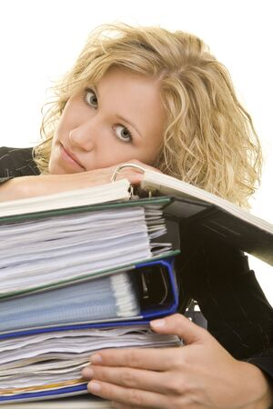 Blonde woman laying her head on a stack of files photo
