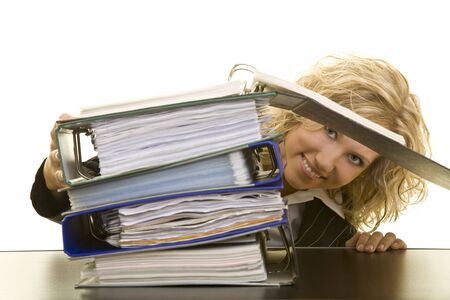 place to learn: Blonde woman looking through a stack of files on a table Stock Photo