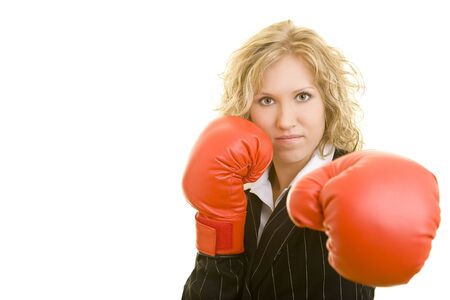 20 25: Blonde business woman with red boxing gloves Stock Photo