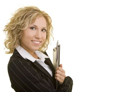 Blonde business woman holding a clipboard photo