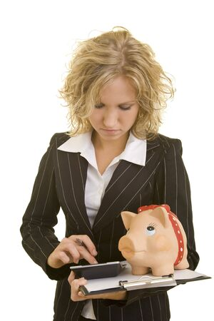 white interest rate: Blonde business woman with calculator, a piggy bank and a clipboard