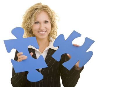 Blonde business woman holding two big jigsaw pieces photo