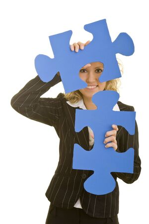 Blonde business woman holding two oversized jigsaw pieces photo